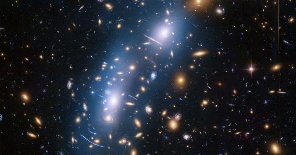 """Stars Torn From Galaxies Let Astronomers """"See"""" Dark Matter"""