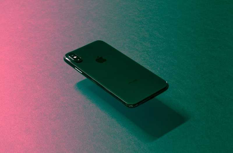 iphone floating over a colorful background