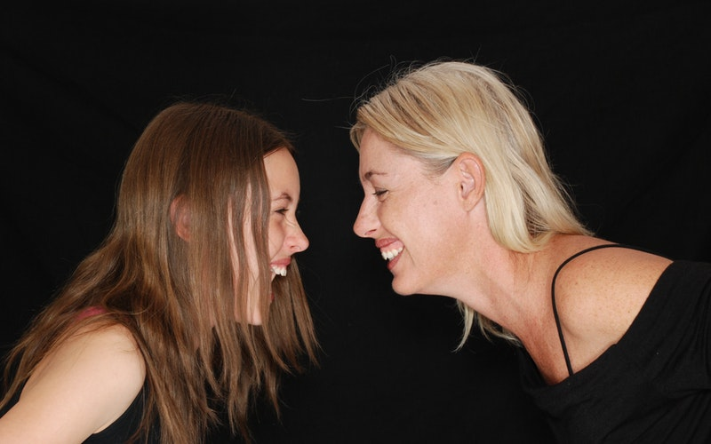 image depicting a mother with her daughter in funny moments